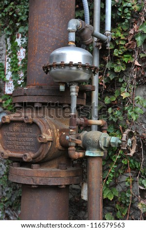 Old machinery - a big valve handle and two gauges are shown.