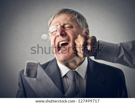 old man gets a fist on the cheek