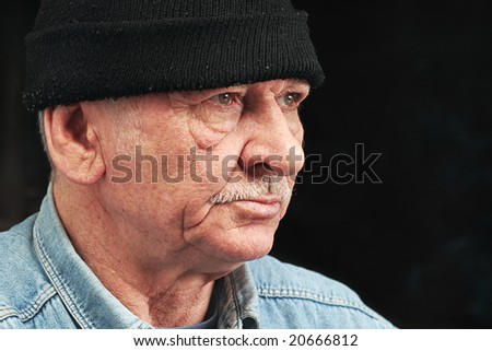 old man in black hat
