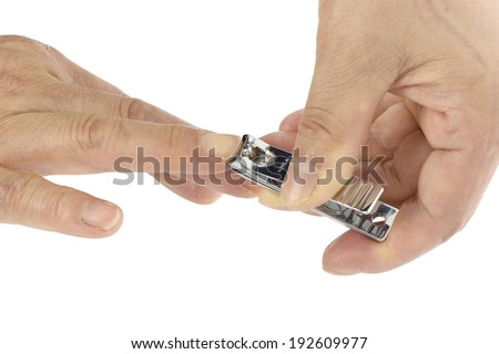 old man's hand with nail clippings, isolated on white