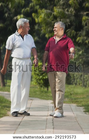 Old men smiling in a park