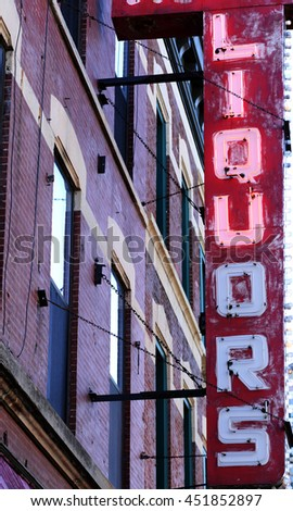 old neon liquors sign