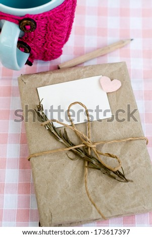 Old notebook with a dry branch of rosemary for love notes