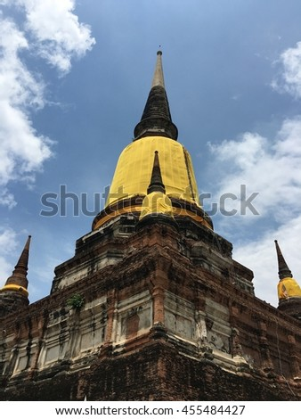 Old Pagoda in ayutthaya Thailand on blue sky cloud background