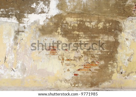 old  painted brick rusty wall can be used as background