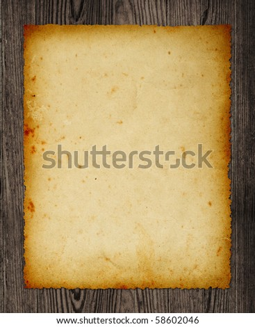Old paper isolated on wooden table, clipping path.