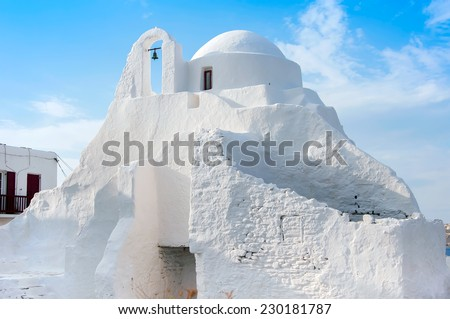 Old Paraportiani 14 century church in the clouds - the most famous and popular place on the island Mikoneos in Greece