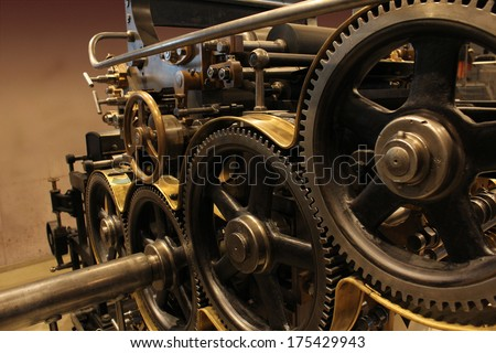 Old printing press - rotary machine - polygraphic equipment - big cog wheel