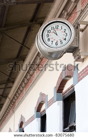 old railway station-clock on a platform