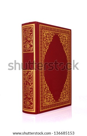 Old red book with gold color ornament on cover isolated on white clipping path