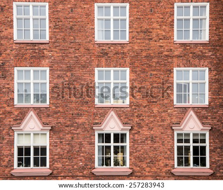 Old red brick wall with windows, building at Temppeliaukio square in Helsinki, Finland