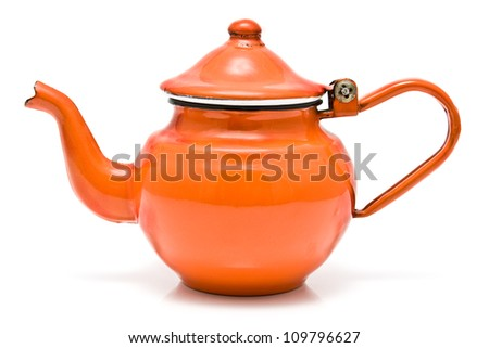 Old red rustic tea pot isolated on white