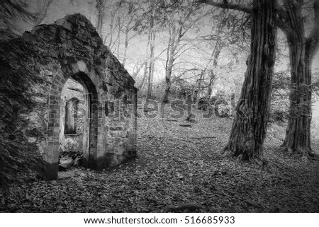 old ruin of a folly in Rectory Wood, Shropshire, UK. Black and white landscape.