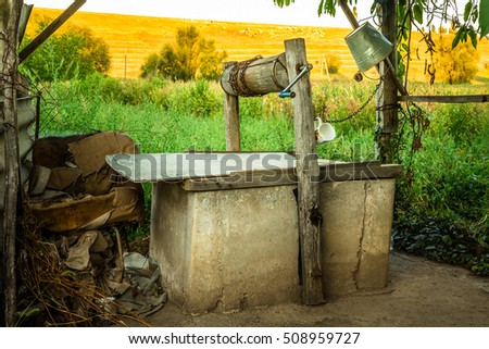Old shabby well in a rural area in Eastern Europe (republic of Moldova)