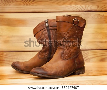 old shoes on wooden board
