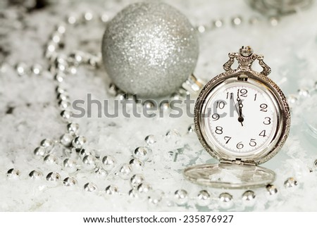 Old silver clock close to midnight and sparkling Christmas decoration - New Year concept