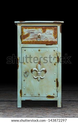 Old steel cabinet isolated on wooden plank floor, interior object, with clipping path