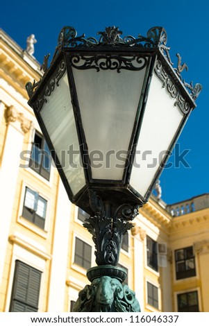 Old street lamp in front of Schoenbrunn Palace in Vienna, Austria
