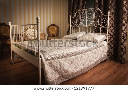 Old style bed in the elegant bedroom