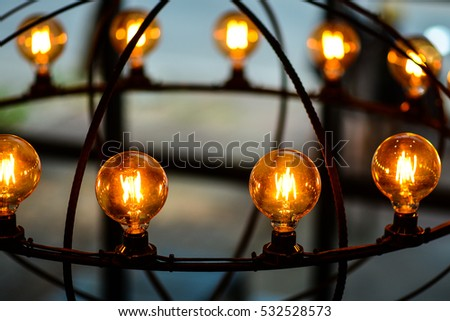 Old Style Glowing Light Bulbs Hanging in Restaurant.