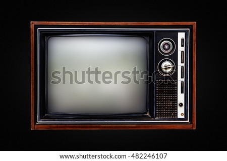 Old television isolated on black background.