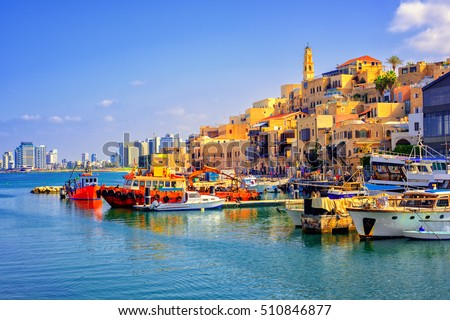 Old town and port of Jaffa and modern skyline of Tel Aviv city, Israel