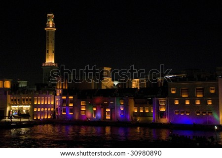 Old Town of Dubai at night taken from boat