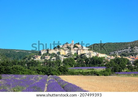 old town on the hill with lavender and wheat farms at Banon, France.