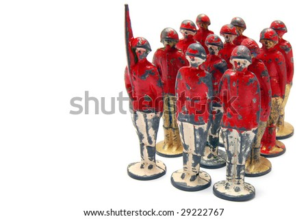 Old toy soldiers isolated on white background