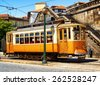 Old tram in Porto, Portugal. Porto is one of the most popular tourist destinations in Europe. - stock photo