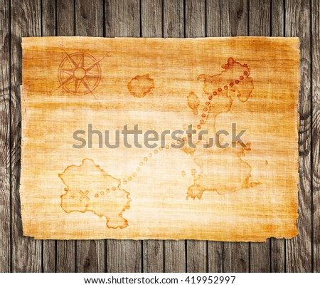 old treasure map, on a wooden grunge background