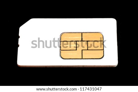Old used sim card on a black background.