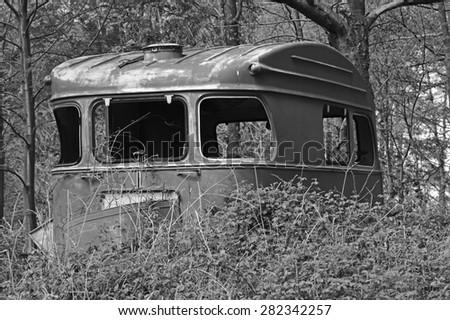Old Vintage Caravan Left And Abandoned In The Forest