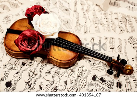 Old violin, musical notes and three roses