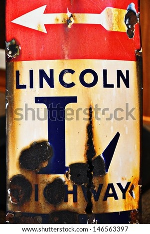 Old weathered Lincoln Highway Road Sign with Arrow Pointing Left