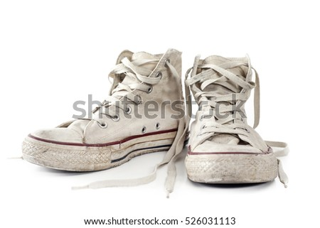 Old white sneakers on white background