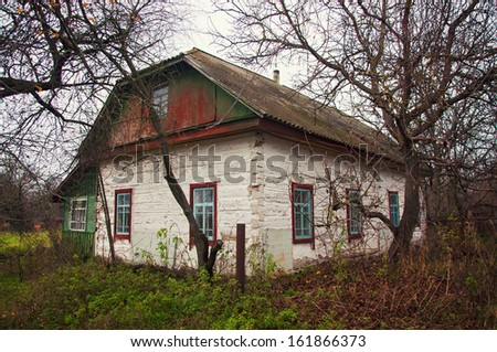 old white wooden house in the village