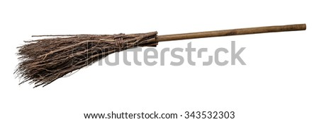 Old wicked witches broomstick isolated on white background.