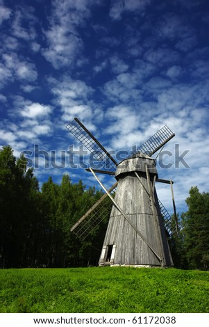 Old windmill in a rural scene, a symbol of ancient alternative energy generation