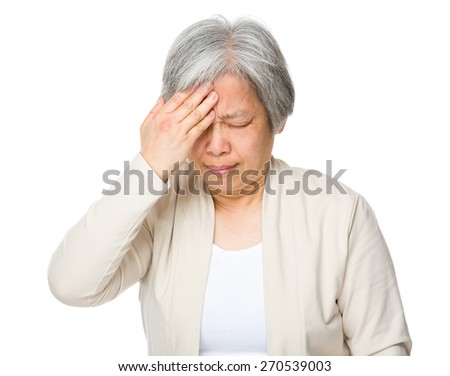 Old woman suffer from headache
