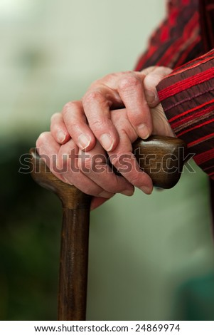 Old woman with a stick