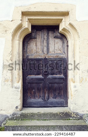 old wood door with metal knob  in Prejmer fortified church, Brasov county, Romania