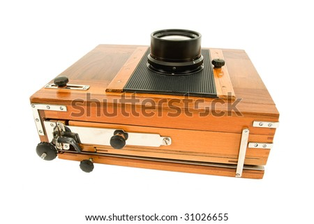 Old wooden analog camera on a white background