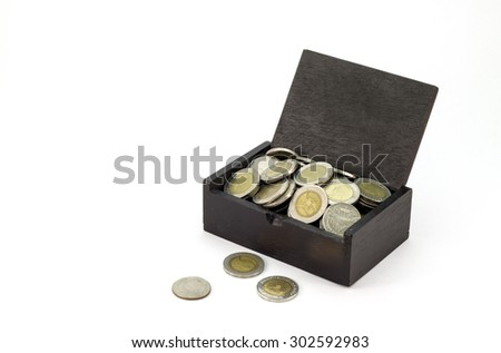 old wooden chest with coins on white background