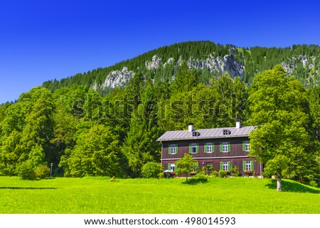 Old wooden traditional house in the mountains in Bavarian Alps, Germany