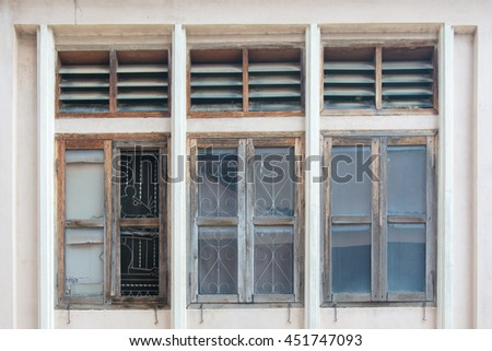 Old wooden window and louver above