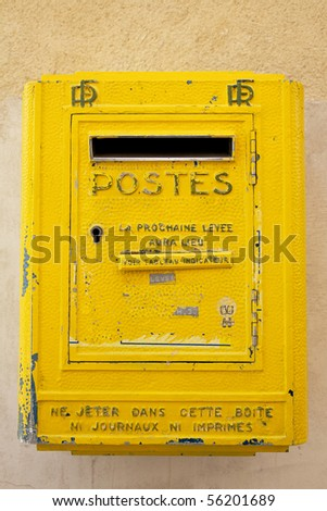 Old yellow French letterbox