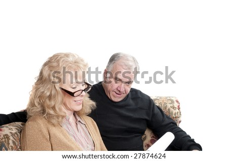 Older couple going over accounts for retirement, isolated on white