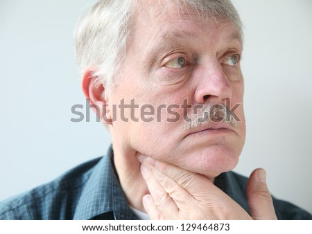 older man with a sore throat or neck