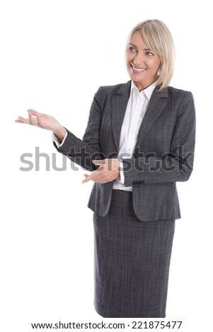 Older or mature isolated businesswoman presenting over white.
